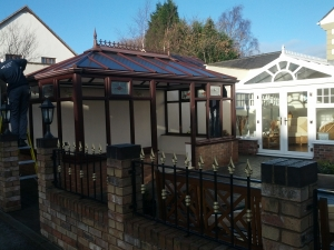 Our old Rosewood conservatory. You can see a member of our team starting to take it down.
