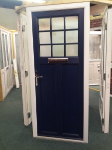 Blue wood grain on white door. Harking back to the designs of old, but with a modern twist and modern low maintenance!