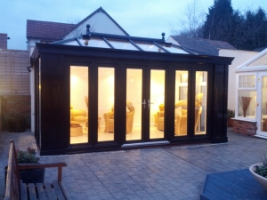 Our stunning Black wood grain Loggia. Bringing a traditional yet modern twist to the glazed extension!
