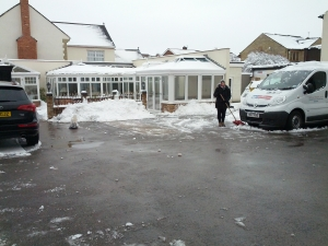 All done! Huge piles of snow, but the main car park and delivery areas are now clear!