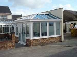 A low profile roof this time around, with Livin room details and stunning, sleek aluminium gutters
