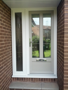 Timber alternative frames with rectangular triple glazed bevel units. Outer frames are white wood grain with the door being Pebble Grey wood grain.