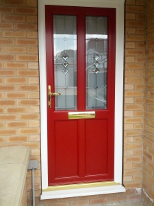 Sprayed red wood grain door with sandblasted and diamond bevel triple glazed units.